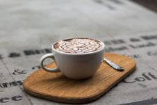 Free Cappuccino In Ceramic Teacup Beside Teaspoon Stock Photo - 109885550