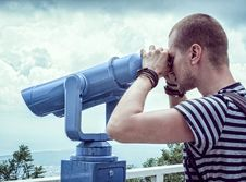 Free Person In White And Gray Stripes Crew Neck T Shit Using Telescope Near White Metal Handrails Under White Clouds During Daytime Royalty Free Stock Photos - 109885698