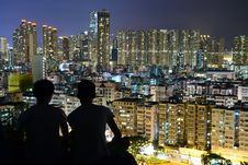 Free Silhouette Of 2 Person On Top Of The Building During Nighttime Royalty Free Stock Image - 109885736