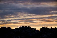 Free Silhouette Of 4 Persons Resting On Top On Mountain During Dusk Stock Images - 109885804