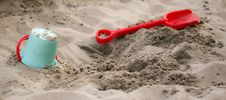 Free Teal Sand Pail Near Sand Shovel Toy Royalty Free Stock Image - 109885876