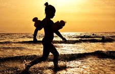 Free Silhouette Of Girl Running On The Seashore During Golden Hour Stock Photo - 109885930