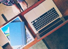 Free Macbook Air Beside 2 Books On Table Royalty Free Stock Images - 109886049