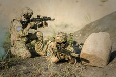 Free Military Sniping Near Rock Royalty Free Stock Photography - 109886117