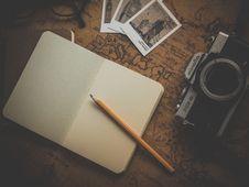 Free Yellow Pencil On White Book Near Camera Royalty Free Stock Photos - 109886158