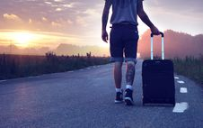 Free Man With Luggage On Road During Sunset Stock Photos - 109886183