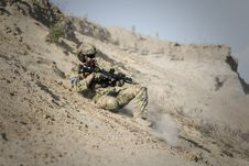Free Soldier Man With Black Rifle Sliding On Cliff Royalty Free Stock Photos - 109886218