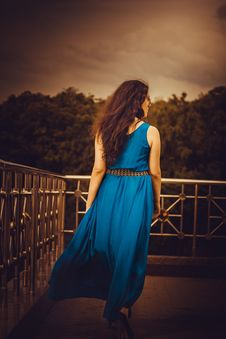 Free Woman Facing Away Wearing Blue Tank Long Dress Looking Out To Trees Royalty Free Stock Photography - 109887387