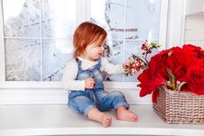 Free Kid S Blue Denim Jumper Sitting On White Wooden Side Table Royalty Free Stock Image - 109887506