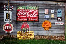 Free Drug Store Drink Coca Cola Signage On Gray Wooden Wall Stock Image - 109888031