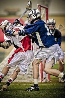 Free Lacross Player Battling On The Field Royalty Free Stock Photo - 109888055