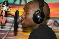 Free Man In Black Tops Wearing Black Headphones Singing In Front Of Black Condenser Microphone Stock Photo - 109888150
