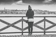 Free Woman Near Wooden Railing And Body Of Water Grayscale Photo Royalty Free Stock Photography - 109888417