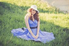 Free Portrait Of A Smiling Young Woman In Grass Royalty Free Stock Photography - 109889307