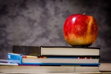 Free Close-up Of Apple On Top Of Books Stock Photography - 109889732