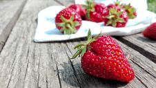 Free Strawberries On Top Of Brown Table Royalty Free Stock Image - 109891276