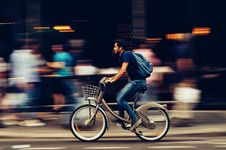 Free Man Riding Bicycle On City Street Royalty Free Stock Photos - 109892218