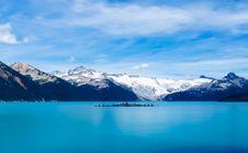 Free Scenic View Of Frozen Lake Against Mountain Range Stock Photo - 109893080