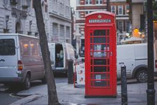 Free Red Telephone Shop Beside Brown Tree Stock Photos - 109893503