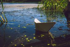 Free Photo Of White Paper Boat On Body Of Water Stock Photos - 109897673