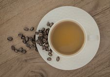 Free White Ceramic Coffee Cup On Brown Wooden Panel Royalty Free Stock Photography - 109900107