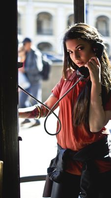 Free Woman In Red T-shirt Holding Telephone Inside Telephone Booth Royalty Free Stock Photography - 109902567