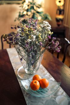 Free Table Decor: Flowers & Oranges Stock Photography - 109903382