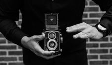 Free Grayscale Photography Of Man Holding Rolleicord Camera Stock Photos - 109904783