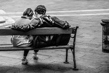 Free Grayscale Photo Of Two Person Sitting On A Bench Stock Photo - 109905020