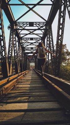 Free Woman Walking On A Train Rail Stock Photos - 109905163