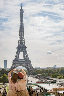Free Photo Of Two Women Posing In Front Of Eiffel Tower, Paris, France During Day Time Stock Photos - 109905273