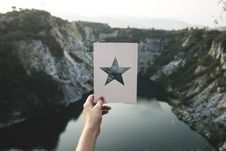 Free Person Holding Star Cutout Paper Facing Mountain Stock Image - 109905571