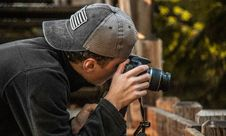 Free Depth Of Field Photography Of Man Holding Dslr Camera Stock Image - 109905701