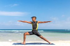 Free Man In Sleeveless Wet Suit Doing Some Aerobics At The Beach Royalty Free Stock Image - 109906296