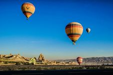 Free Four Beige Hot Air Balloons Flying Stock Photos - 109906393