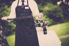 Free Man Wearing Apron Holding Sword Royalty Free Stock Photos - 109907278