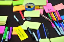 Free Photo Of Sticky Notes And Colored Pens Scrambled On Table Stock Photos - 109907283