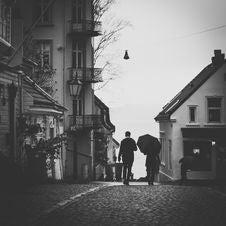 Free Grayscale Photo Of Man Beside Woman Under Umbrella Walking On Pavement Stock Photo - 109907470