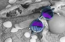 Free Neo Chrome Sunglasses With Silver And Black Frame On Brown Firewood Stock Photos - 109907663