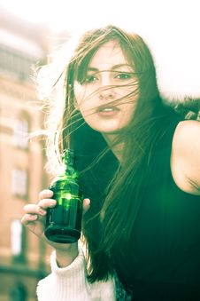 Free Woman In Black Sleeveless Shirt Holding A Bottle Stock Photo - 109907730
