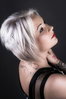 Free Woman Wearing Black Shirt With Tattoo And Red Lipstick Royalty Free Stock Photography - 109907877