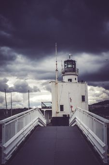 Free View Of Cloudy Skies On Lighthouse Royalty Free Stock Photography - 109907937
