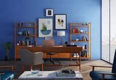 Free Brown Wooden Desk With Rolling Chair And Shelves Near Window Royalty Free Stock Photo - 109908035