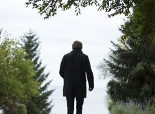 Free Shallow Focus Photography Of Man Wearing Black Coat And Black Pants Standing Beside Green Trees Stock Photo - 109908060