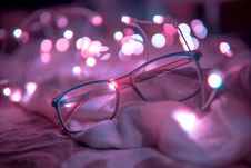 Free Shallow Focus Photography Of Blue-framed Eyeglasses Near String Lights Royalty Free Stock Photo - 109908135