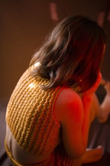 Free Woman Wearing Yellow Knitted Crop-top Shirt Sitting On Floor Stock Photo - 109908250
