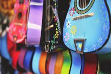Free Blue, Purple And Green Acoustic Guitars Stock Image - 109908251