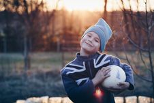 Free Selective Focus Photography Of Boy Wearing Blue United Kingdom Print Zip-up Jacket Carrying White Ball Royalty Free Stock Photo - 109908285