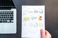 Free Person Holding Chart And Bar Graph Stock Photo - 109908300