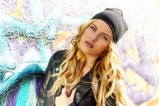 Free Woman Wearing Black Leather Jacket And Black Knit Cap Stock Image - 109908371